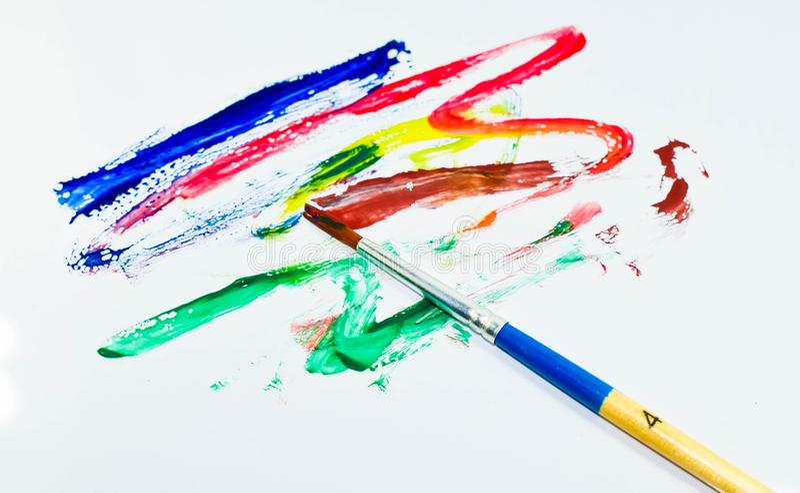 Cor e escova de pintura fotografia de stock royalty free