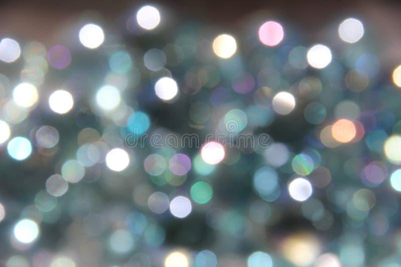 A cor pastel Sparkles com lite Grey Background fotografia de stock royalty free