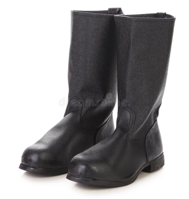 Cor preta alta das botas de couro. foto de stock