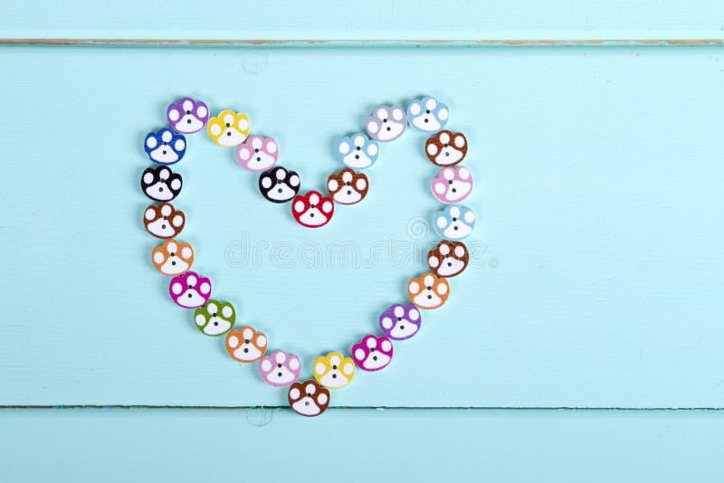 Coração apresentado dos botões fotografia de stock royalty free