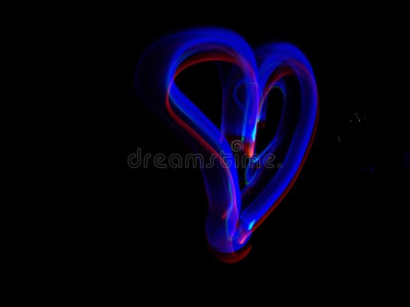 Coração azul e vermelho de néon foto de stock royalty free