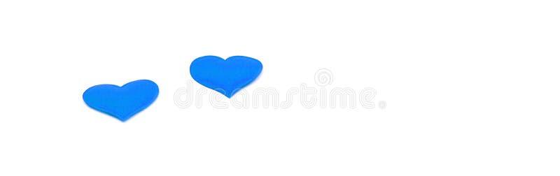 Coração azul em um fundo branco isolado como um panorama, espaço para o texto imagem de stock