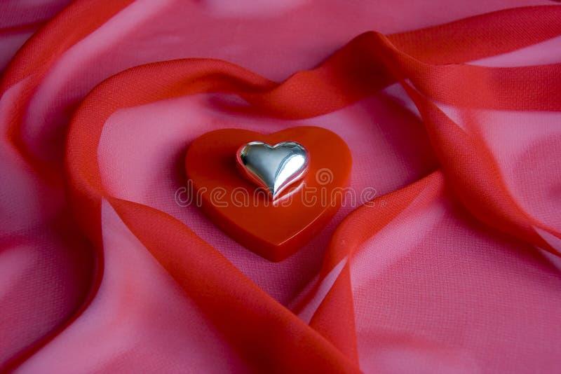 Coração brilhante brilhante em uma caixa pequena como um coração fotografia de stock royalty free