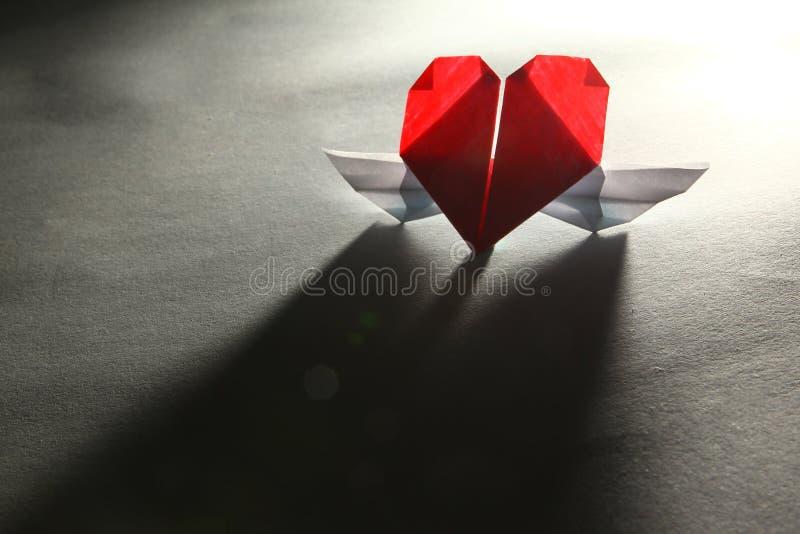 Coração com asas - relacionamento interurbano imagem de stock