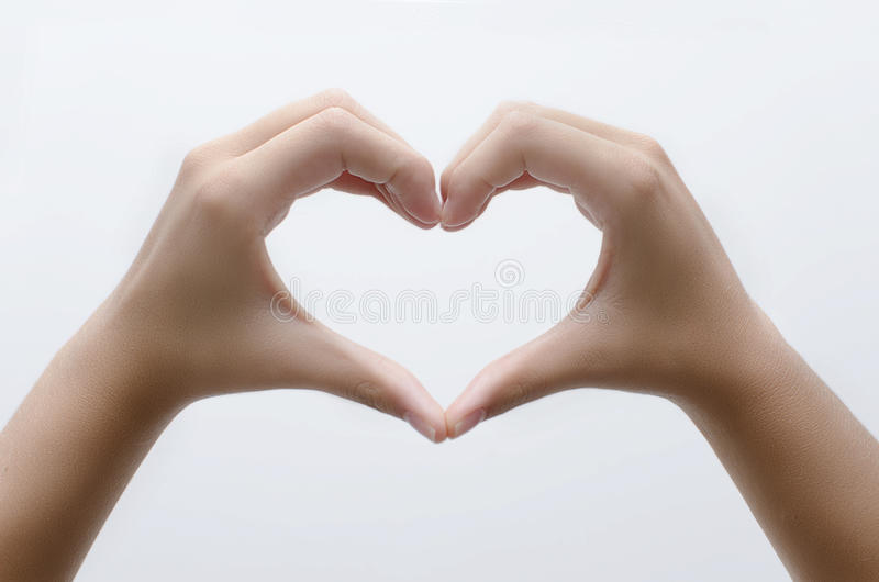 Coração com mãos imagem de stock