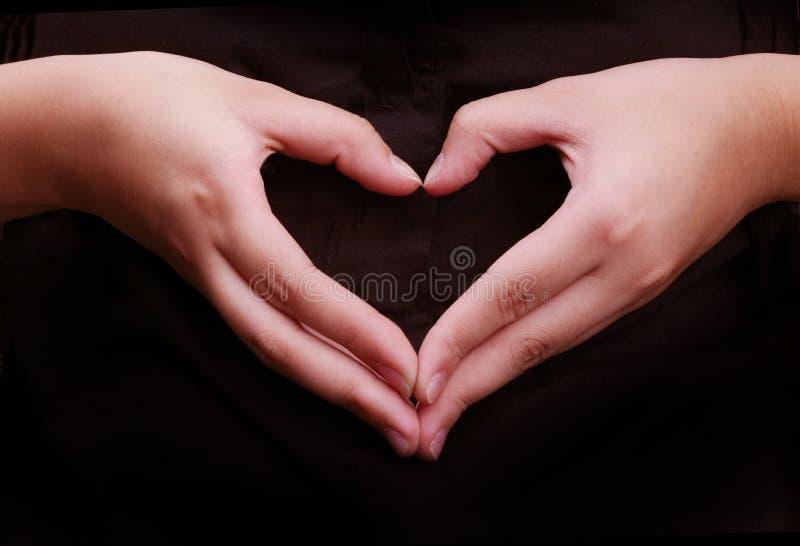 Coração da forma da mão fotos de stock