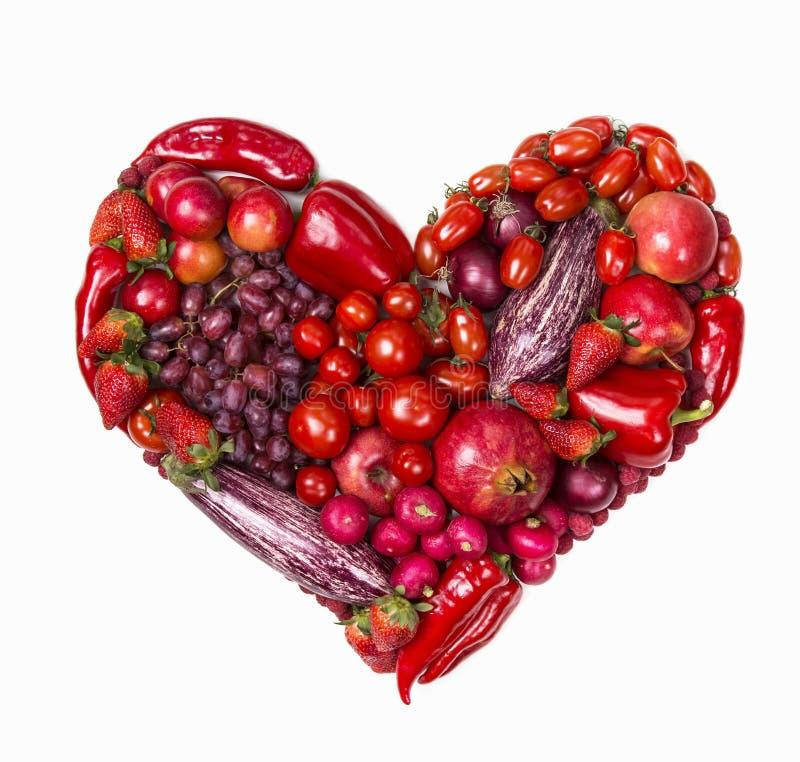 Coração de frutas e legumes vermelhas imagem de stock
