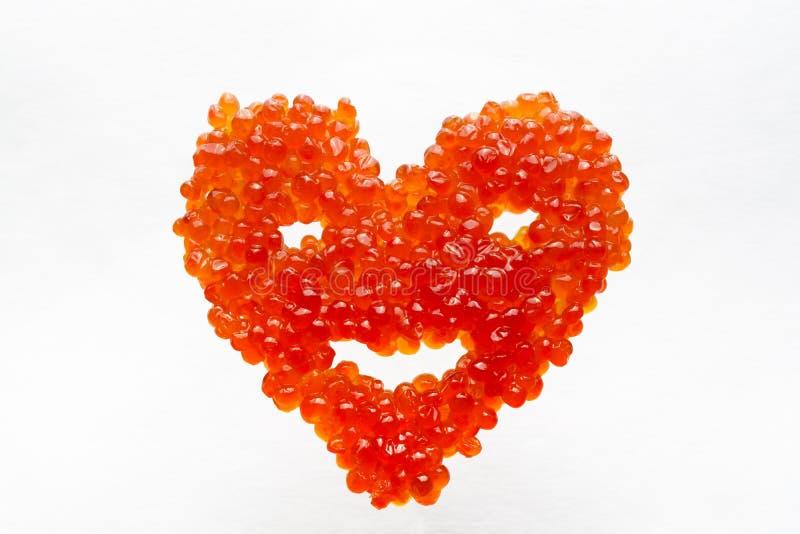 Coração de sorriso feito do caviar vermelho imagem de stock