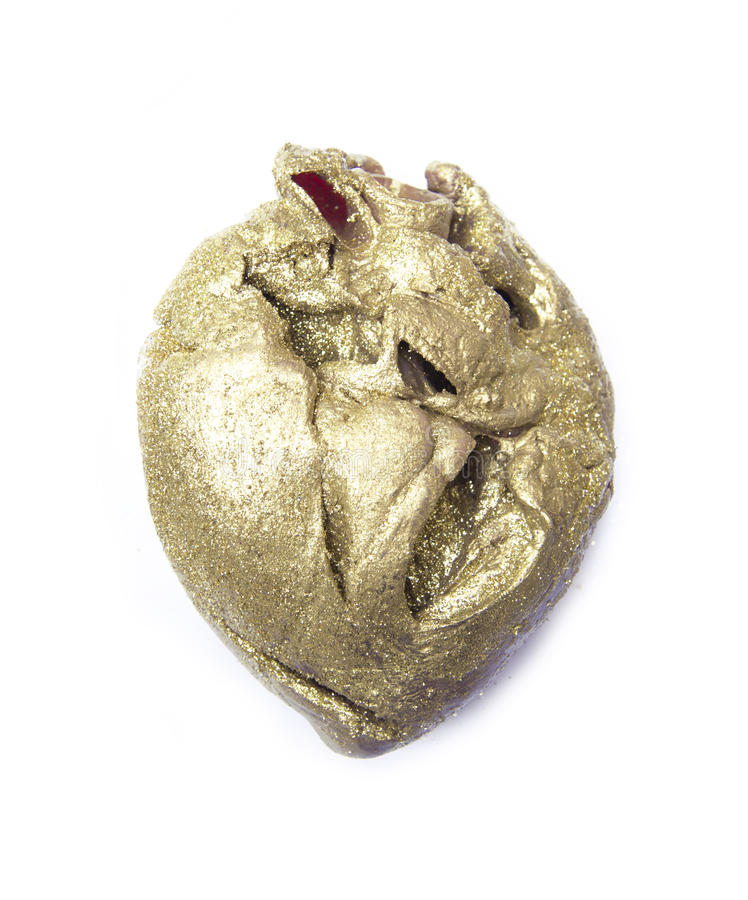 Coração do ouro fotografia de stock