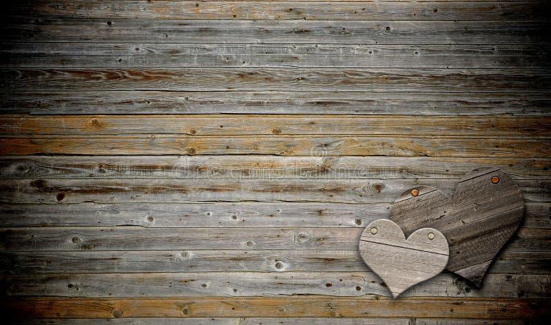 Coração dois no fundo de madeira foto de stock