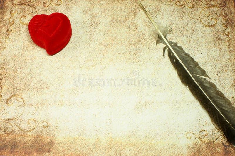 Coração e pena imagens de stock royalty free