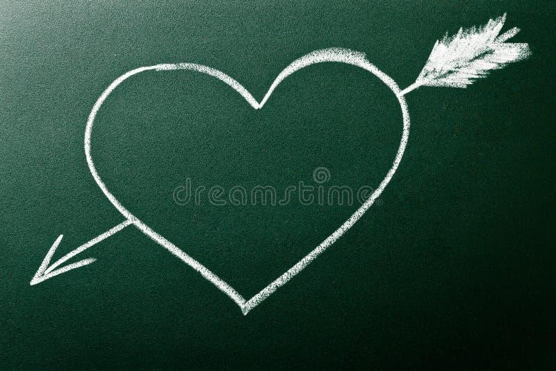 Coração e seta como o conceito do amor na primeira vista imagem de stock royalty free