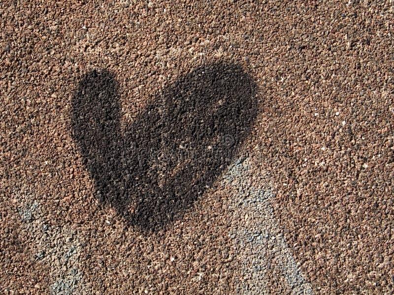 Coração em uma parede imagem de stock