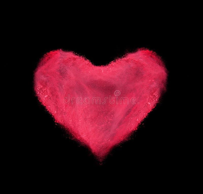 Coração feito da explosão vermelha do pó no preto foto de stock royalty free