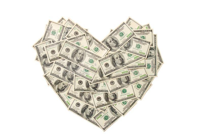 Coração feito de cem notas de banco do dólar isoladas imagens de stock royalty free