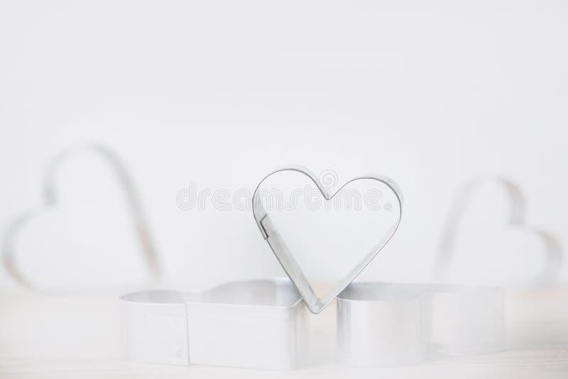 Coração macio do metal no branco foto de stock