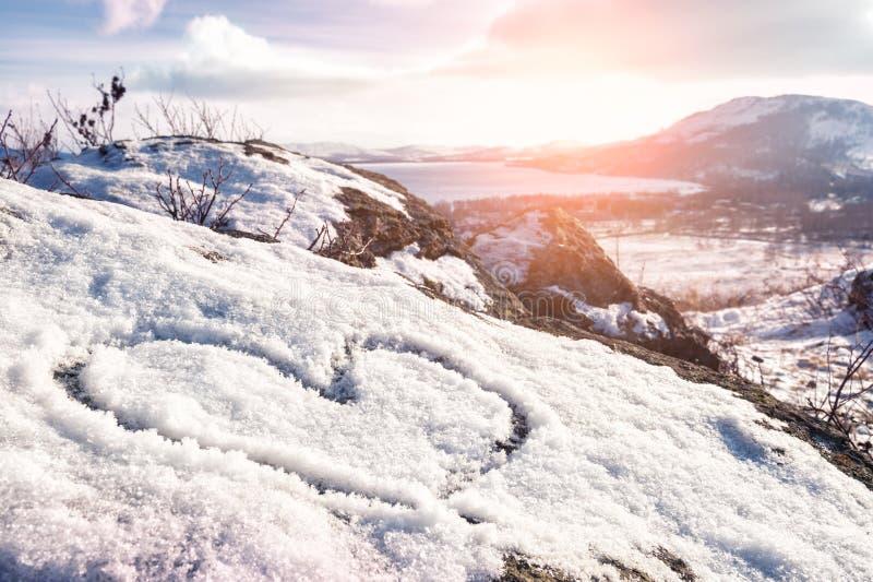 Coração na neve foto de stock