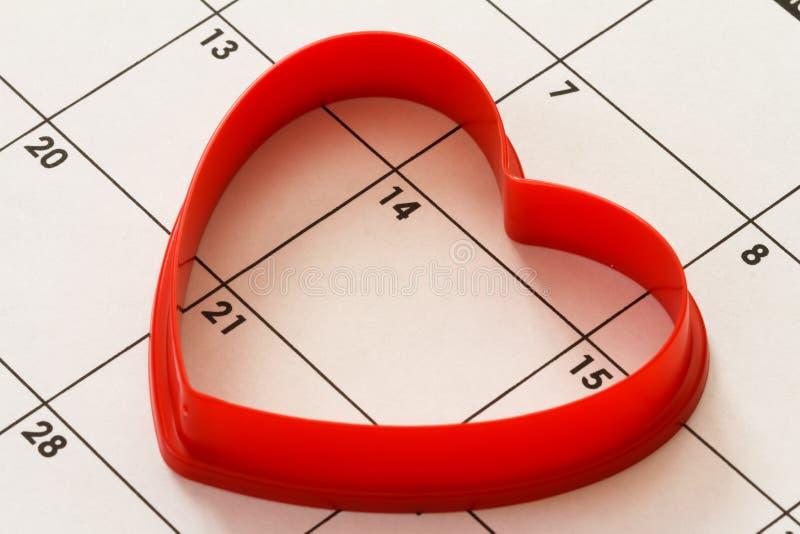 Coração no calendário fotografia de stock