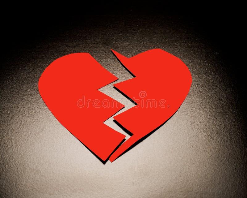 Coração quebrado vermelho imagens de stock