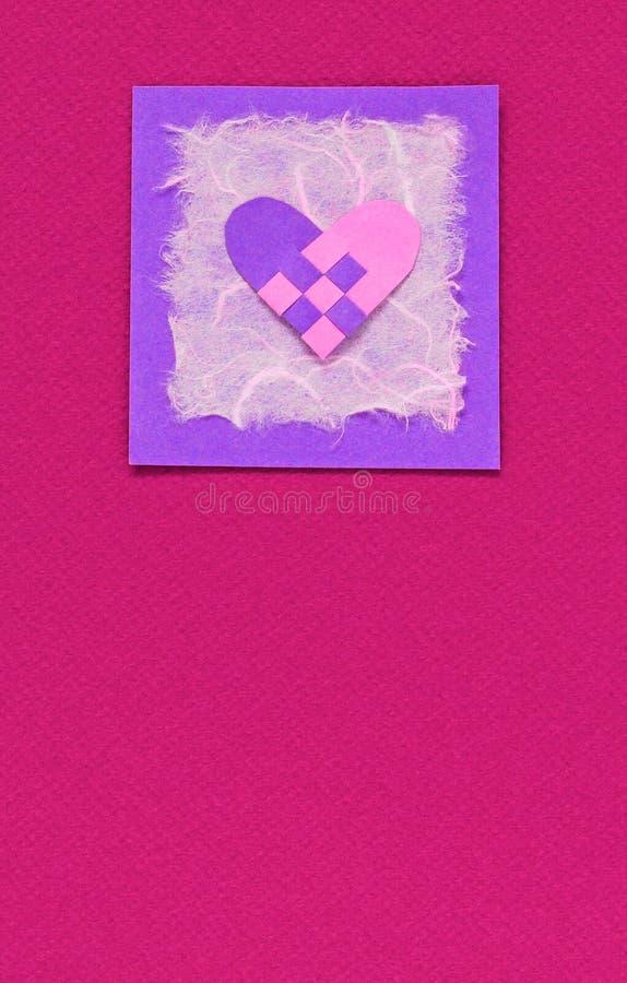 Coração tecido em um fundo cor-de-rosa fotos de stock royalty free