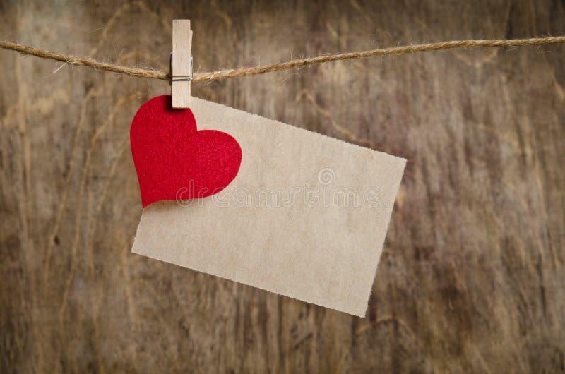 Coração vermelho da tela com a folha de papel foto de stock royalty free