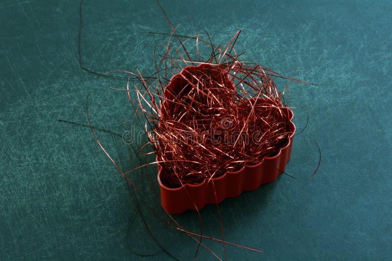 Coração vermelho Shredded imagens de stock