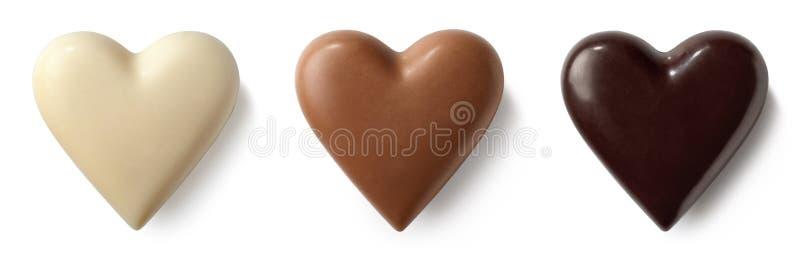 Corações do leite de chocolate três, os escuros e os brancos fotografia de stock royalty free