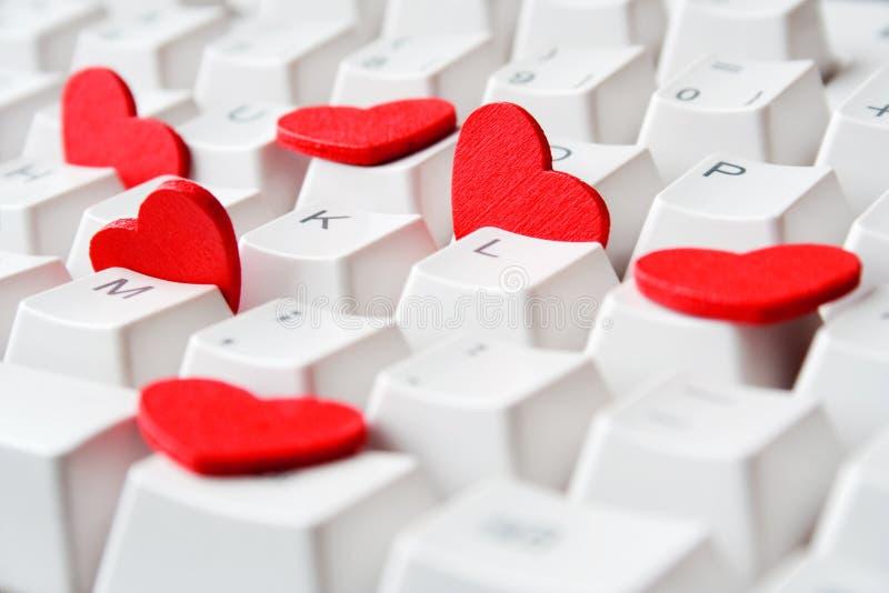 Corações no teclado fotos de stock
