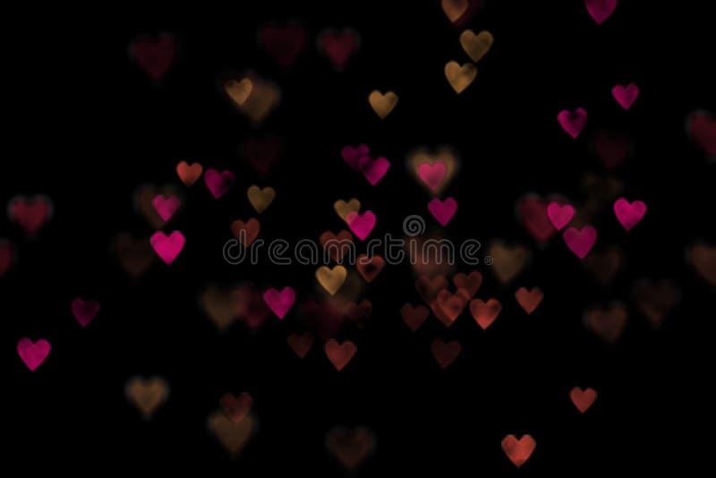 Corações vermelhos e amarelos do bokeh imagem de stock royalty free