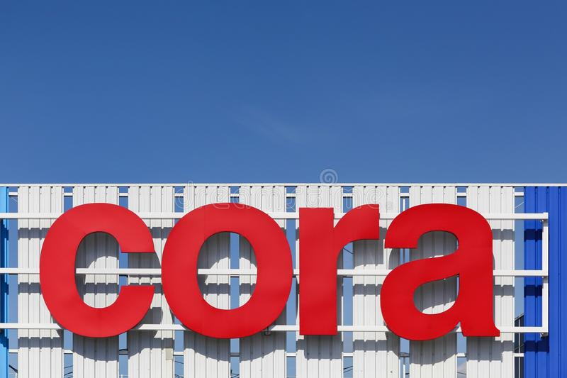 Cora sign on a facade. Mondelange, France - May 18, 2015: Cora sign on a facade. Cora is a retail group of hypermarkets located in France and Europe. Cora was stock photo