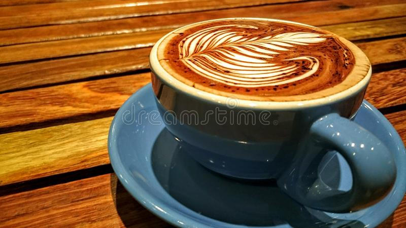 Coraggio kaffekopp royaltyfria foton