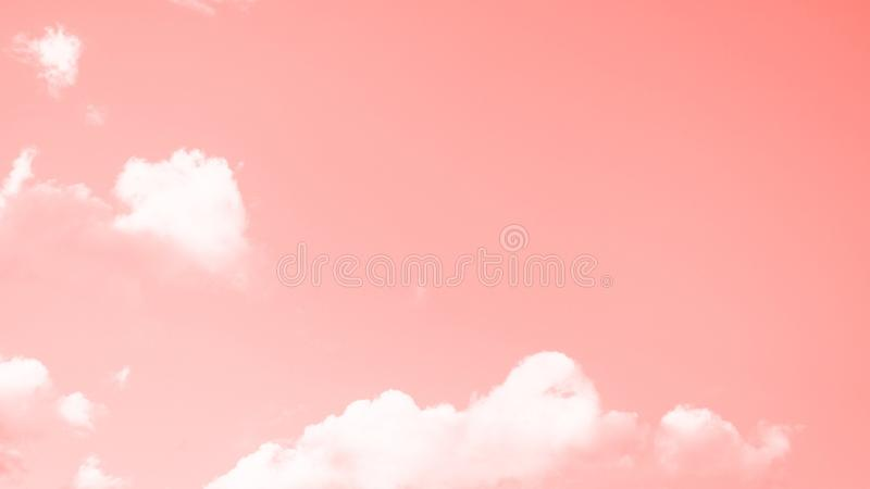 Coral color sky background with small white clouds. 16:9 panoramic format stock photo