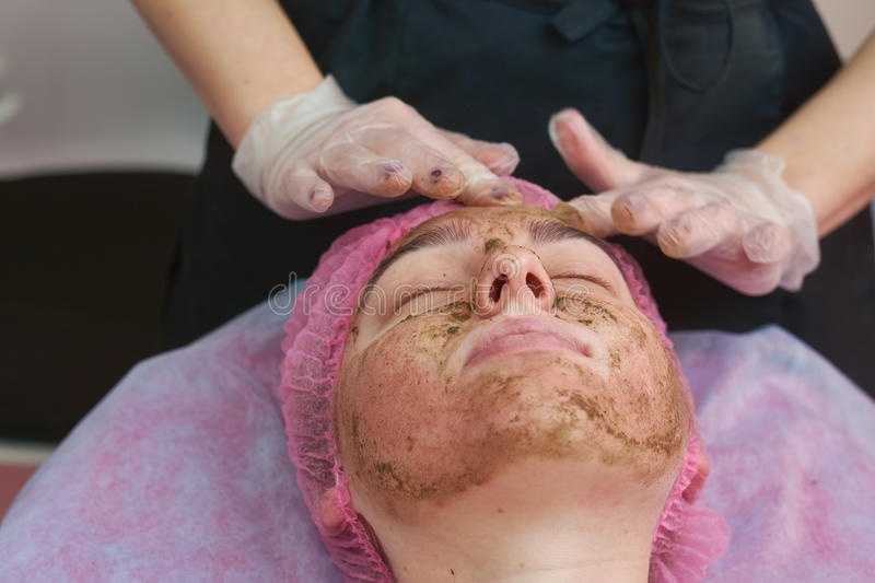 Coral face peel, young woman. stock image