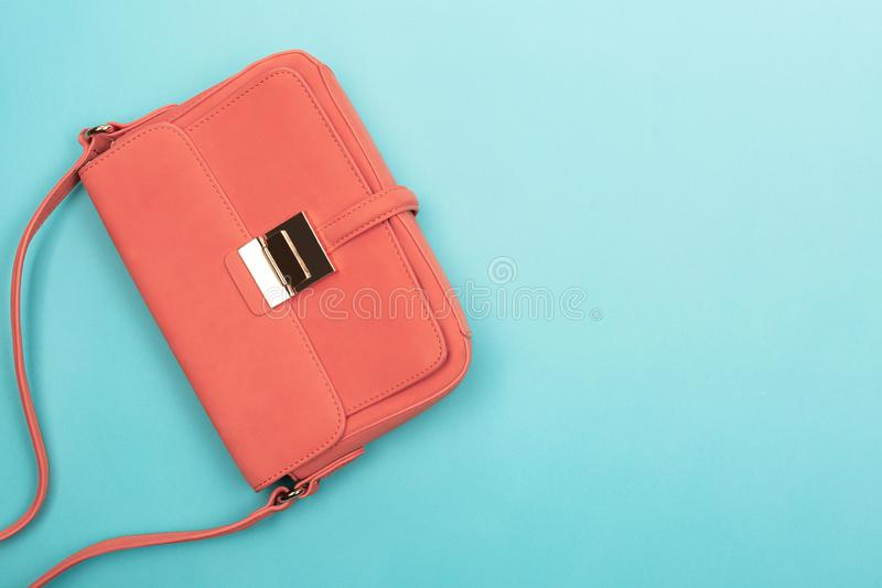 Coral fashion bag on contrast background stock photos