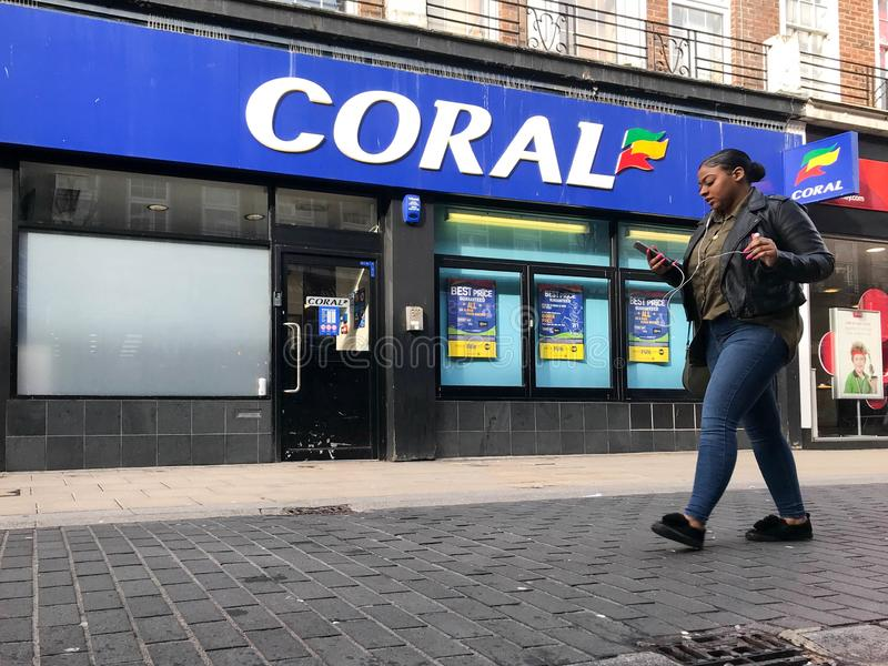 CORAL store. Coral Group plc is a British based betting and gambling company. It is based in London. It previously owned the Hilton hotel brand outside the royalty free stock images