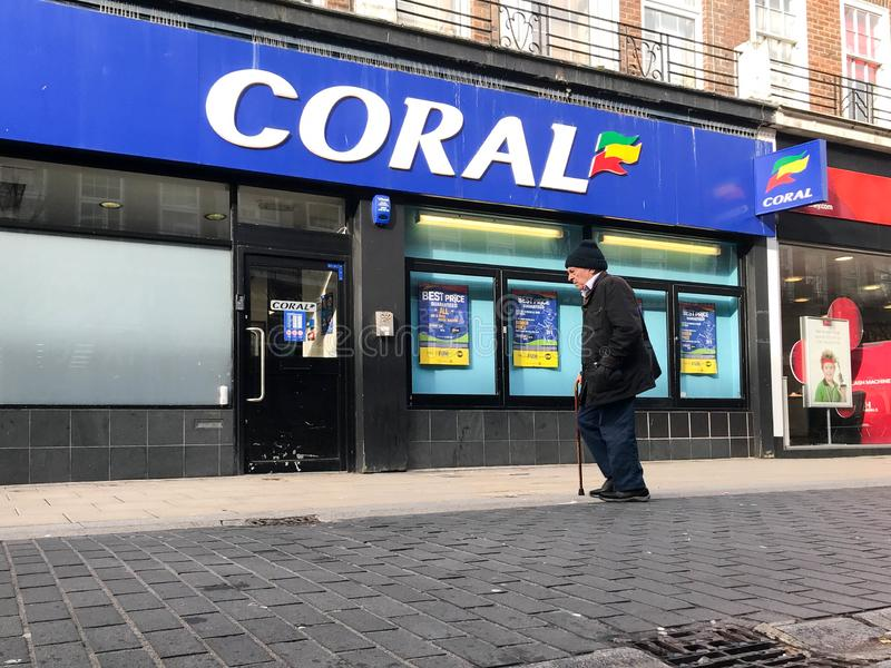 CORAL store. Coral Group plc is a British based betting and gambling company. It is based in London. It previously owned the Hilton hotel brand outside the stock images