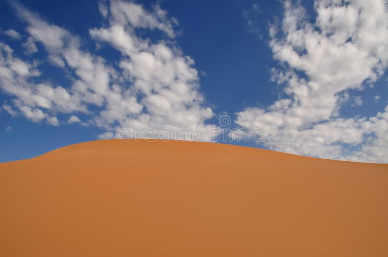 Download Coral Pink Sand Dune And Blue Sky With White Clouds Stock Photo - Image: 31343092