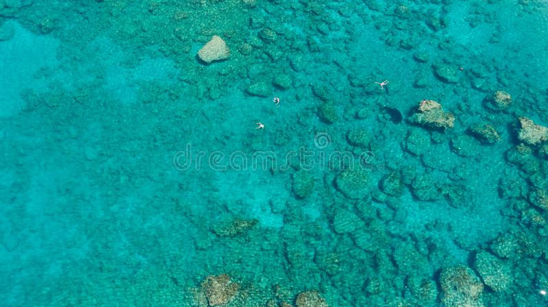 Coral Reef from a drone aerial birds eye top down view. Rocks and blue turquoise water. Corals and sea life background. royalty free stock images