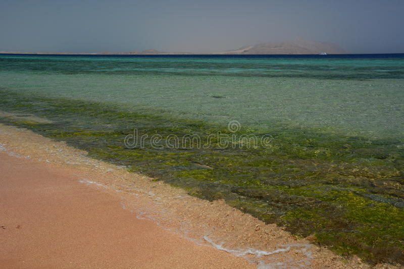 Coral reef and Tiran island. Sharm El Sheikh. Red Sea. Egypt. Sharm el Sheikh is a city situated on the southern tip of the Sinai Peninsula, on the coastal strip royalty free stock images