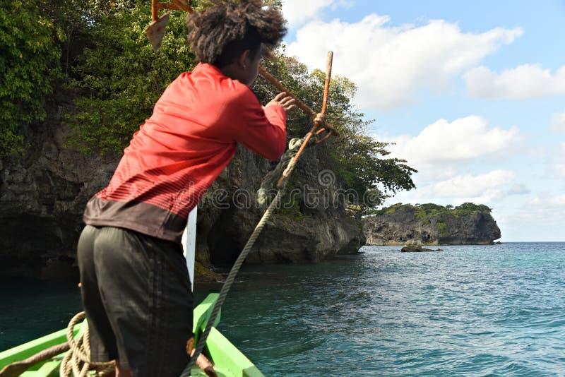 Burmese man throwing anchor at coral reef. Coral reef, Young Man, Throw Anchor, Republic of the Union of Myanmar, Birma, Burma, Andaman Sea, Ngwe Saung, Fisher royalty free stock images