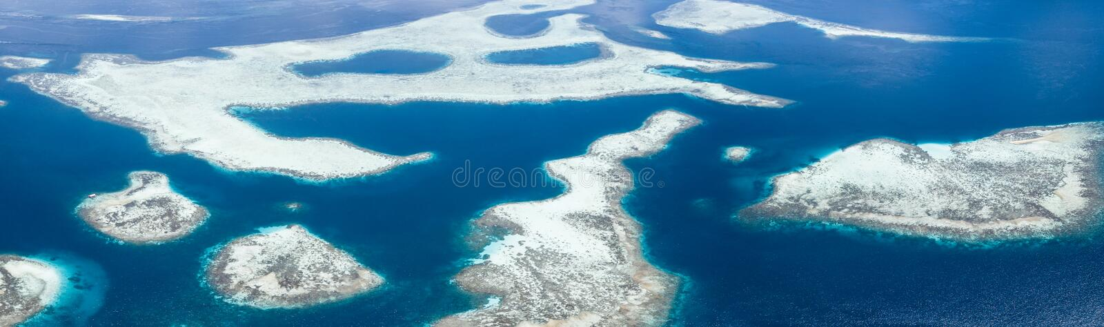 Aerial View of Coral Reef Seascape in Raja Ampat. The coral reefs found throughout Raja Ampat, Indonesia, are home to extraordinary marine bodiversity. This royalty free stock image