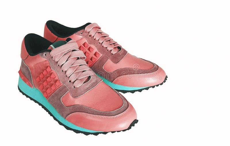 Coral sneakers royalty free stock image