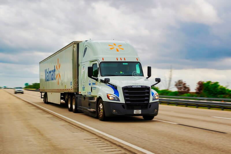 Walmart truck driving on the US Interstate 869, Sawgrass Express Way on a cloudy day. Coral Springs, Florida/USA - April 11, 2020: Walmart truck driving on the royalty free stock image