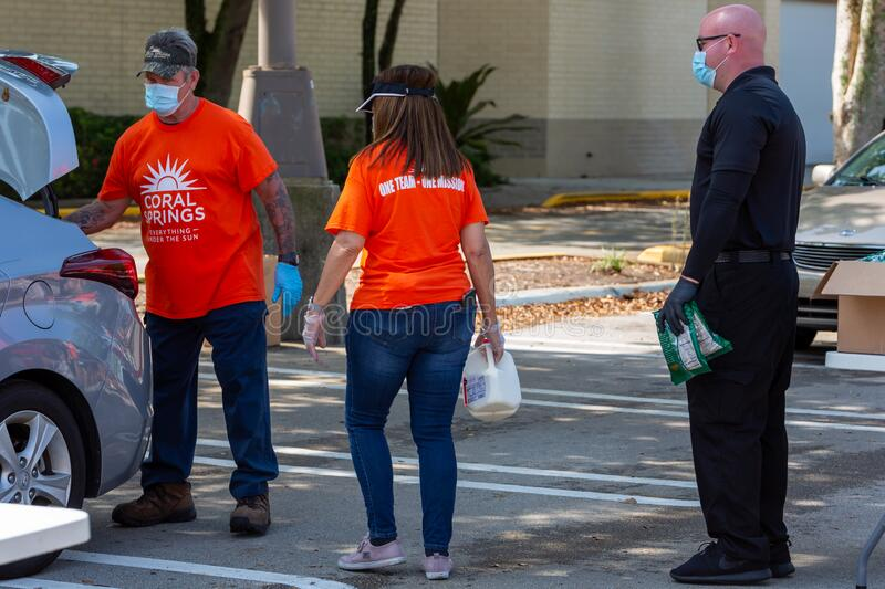One Team - One Mission, Food Distribution with Coral Springs Police Department officers and Coral Springs Fire Department royalty free stock images