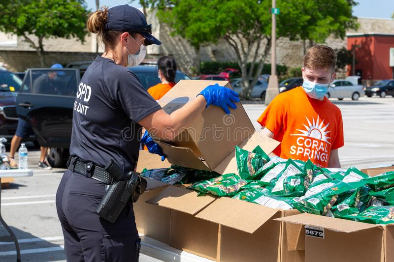 One Team - One Mission, Food Distribution with Coral Springs Police Department officers and Coral Springs Fire Department stock photos
