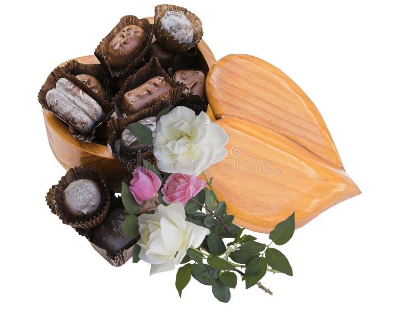 Corazón, caramelo y rosas foto de archivo libre de regalías