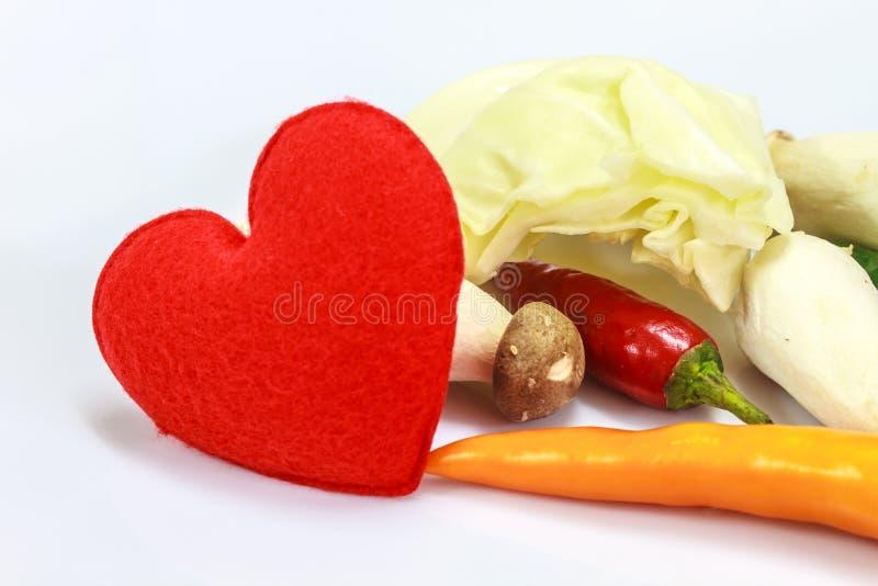 Corazón con las verduras frescas para cocinar imagen de archivo