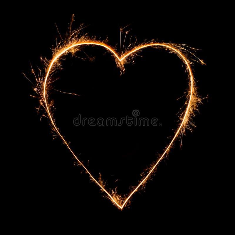 Corazón de la bengala en fondo negro foto de archivo libre de regalías