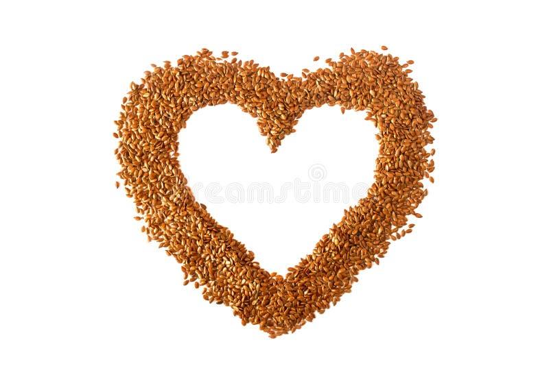 Corazón de la muestra alineado con las semillas de lino Dieta sana del concepto, cáncer imágenes de archivo libres de regalías