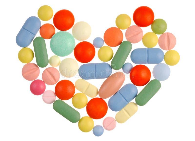 Corazón de las píldoras imagen de archivo